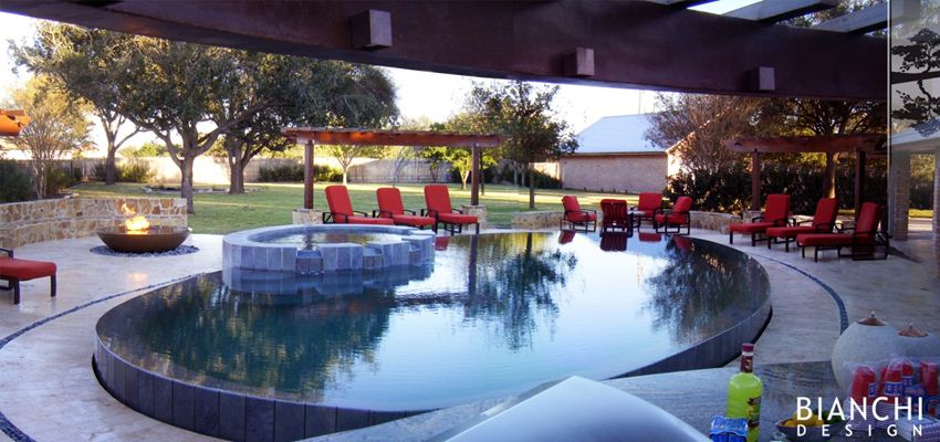AFTER: The pool was transformed into a raised overflow for capturing reflections, and inviting seating areas, landscape, fire, and arbors were set around its perimeter.